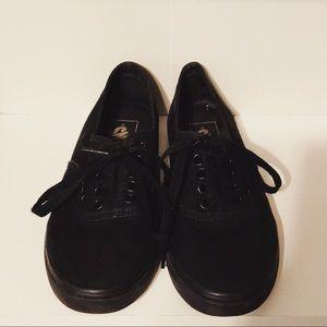 Black lace-up Vans